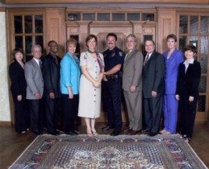 Original Partners of the Family Justice Center: Jackie Perkins, Office of Community Services; Major Bryan Boney, West Monroe Police Department; Andre Jones, Legal Services of North Louisiana; Sgt. Renee Smith, Ouachita Parish Sheriff's office; Kim Golden, Ouachita Parish Policy Jury; Chief Ron Schleuter, Monroe Police Department; Jerry Jones, District Attorney; Marcus Clark, Chief Judge, 4th Judicial District; Linda Lochbrunner, LSU Health Science Center;  Judy Bell, The Wellspring